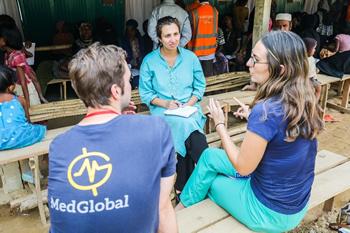 Dr. Rohini speaks with volunteers