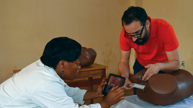 PHR consultant Georges Kuzma and Panzi Hospital's Dr. Nadine Neema Rukunghu test a forensic documentation app.