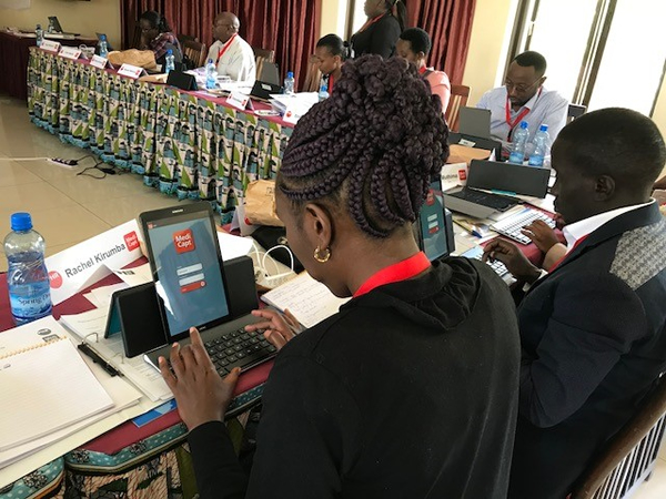 Kenyan health professionals learning to use MediCapt at a PHR training.