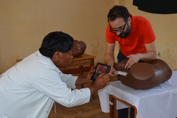 PHR partner Dr. Nadine Neema Rukunghu of the DRC's Panzi Hospital and PHR consultant Georges Kuzma test MediCapt's secure capture feature for forensic photography.