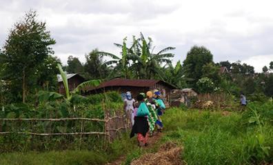 Women walk through the village of Kavumu in the Democratic Republic of the Congo.   PHR Photo