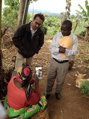 PHR legal and justice expert Georges Kuzma and a police investigator interview a Kavumu resident about alleged perpetrators.   PHR Photo