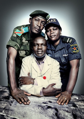 Captain David Kazadi Nzengu (standing left), a military prosecutor; Dr. Désiré Alumeti (seated), a pediatric surgeon at Panzi Hospital; and Uvoya Fwaling Honorata (standing right), an officer in the Congolese police's Women and Child Protection Unit. All three trained in best forensic practices with PHR. | Platon for The People's Portfolio