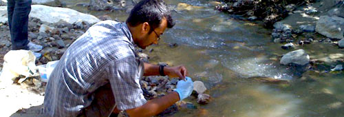 Dr. Basu samples water from the Rio Tzala in the Marlin Mine investigation, Guatemala
